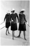 Dees triplets modeling look-alike outfits a