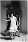 Look-alike dresses being modeled by Dees triplets b