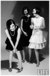 Look-alike dresses being modeled by Dees triplets c