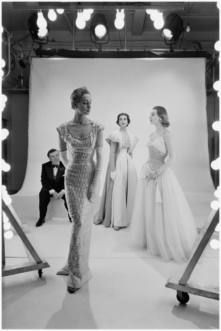 Norman Hartnell and models pose for a Vogue shoot Vogue-1953 Norman Parkinson Archive