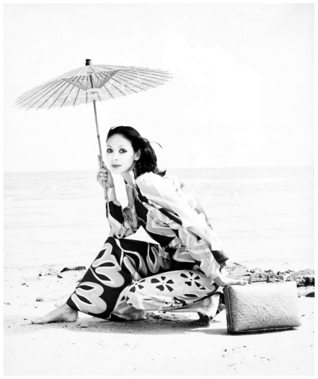 Batika, model Robin Fong on beach with umbrella, photograph by Bruno Benini, Melbourne, Victoria, Australia, 1975