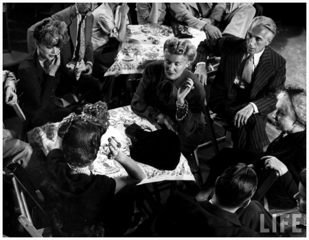 Group from Vogue magazine among audience at jam session in studio of LIFE photographer Gjon Mili. Conde Nast President Iva Patcevitch (2R) & Editor-in-Chief Edna Woolman Chase (R) w. unident. others 1943 Gjon Mili NYC