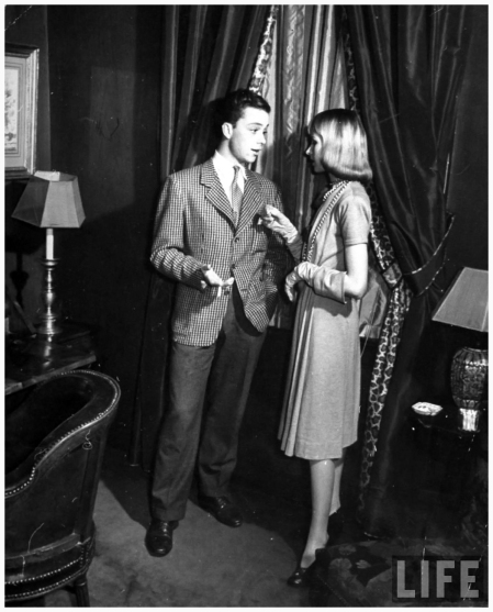 Halldis Prince (R) talking to actor Freddy Bradley at a party hosted by publisher Conde Nas 1940 NYC John Phillips