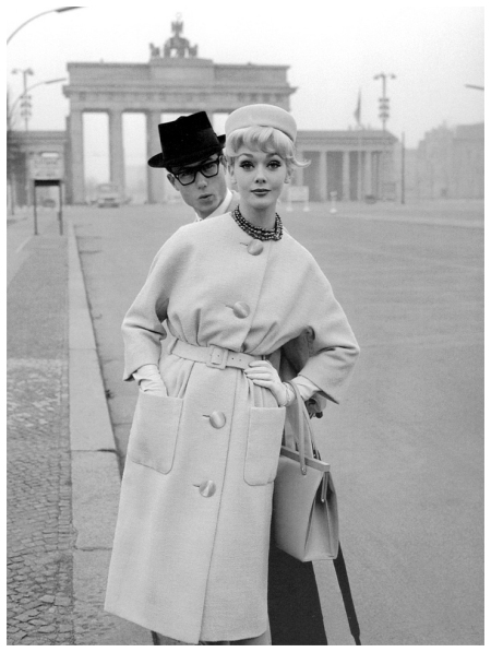 Ina Balke in coat by Gehringer & Glupp in front of Brandenburg Gate, Berlin, photographed for Beyer Moden, Spring:Summer 1960
