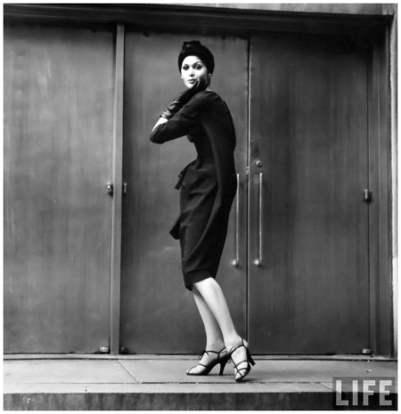"Isabella Albonico in the latest style, the ""bag dress"" a Balenciaga copy in black crèpe , photo by Yale Joel, Sept. 1957, New York, New York"