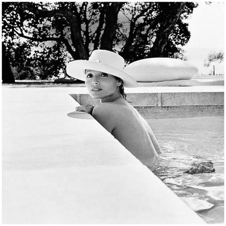 Italian furniture designer Elsa Martinelli at her house in Saint Tropez in 1975, photographed by Leombruno-Bodi
