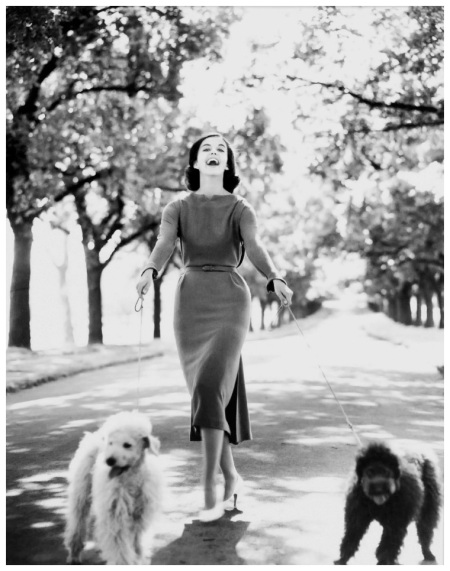 model Margo McKendry with two dogs, fashion by Sharene Creations, location Fitzroy Gardens, by Bruno Benini, Melbourne, Victoria, Australia, 1961