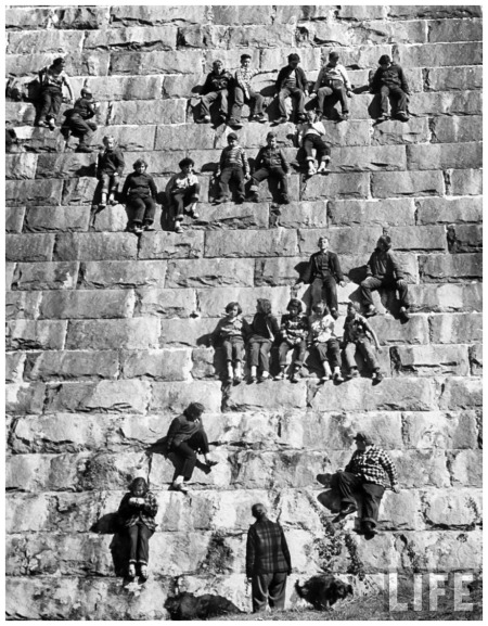 On the high wall of Croton Dam, students taking seats for a geology lectutre 1953