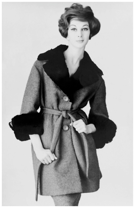 Photograph of Australian model Janice Wakely wearing a coat with a fur collar and fur cuffs, 1959