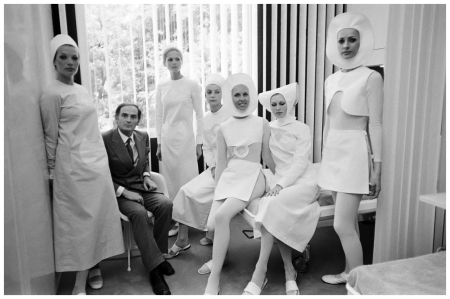June 1970, Paris, France --- Designer Pierre Cardin with Models in Nursing Uniforms --- Photo Alain Dejean/Sygma/Corbis