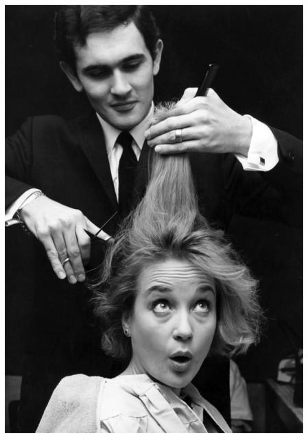 Actress Sylvia Syms having her hair cut by Roger, the short hair cut expert at Vidal Sassoon's