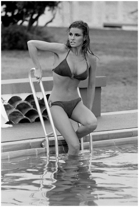 American actress Raquel Welch enters a chilly pool during the filming of 'Lady in Cement', 1968. Photo by Terry O'Neill