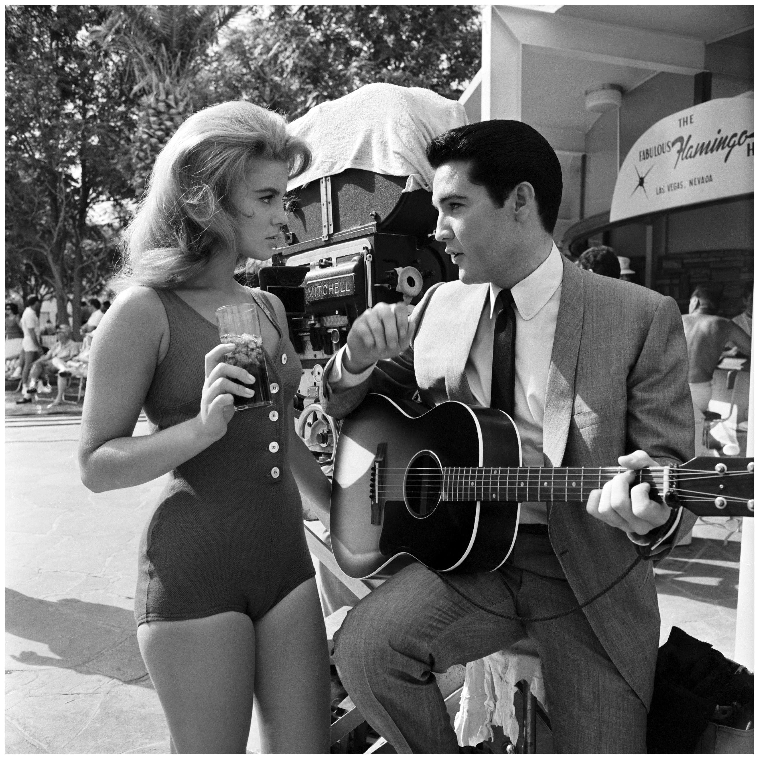 Ann-Margret and Elvis Presley rehearse the duet they are to sing in the film