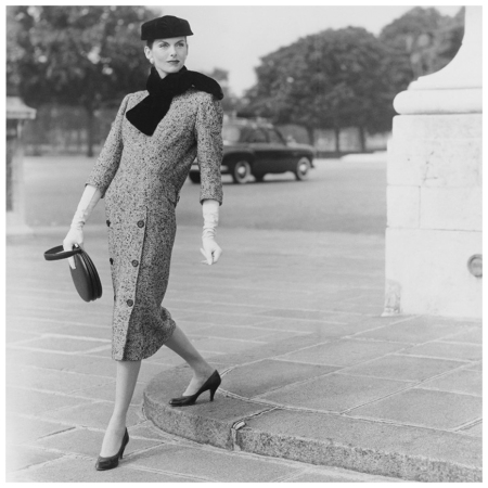 Anne-Saint Marie - Model wearing Balenciaga tweed dress with double-breasted skirt, fur ascot, hat, and gloves, holding circular handbag 1955