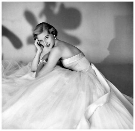 Debutante Olivia Endicott Hutchins wearing a white tulle dress. Circa November 1953 Photo Clifford Coffin