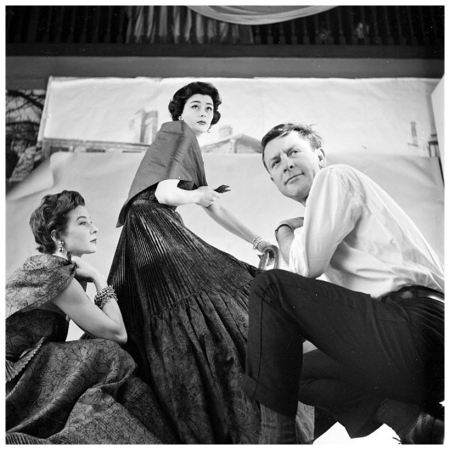 Fashion photographer Henry Clarke studies pose with Bettina and Anne Gunning wearing Lanvin-Castillo gowns for editorial in British Vogue, photo by Walter Carone, Feb. 1953