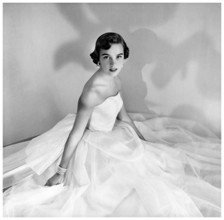 Lucy McClellen wearing strapless white net dress. Circa November 1953 Photo Clifford Coffin