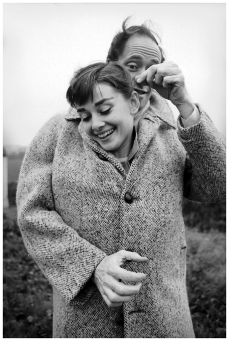 Mel Ferrer with his coat buttoned up around his wife, actress Audrey Hepburn (1929-1993), on a country road outside Paris, 1956. (Photo by Michael Ochs Archives:Getty Images)