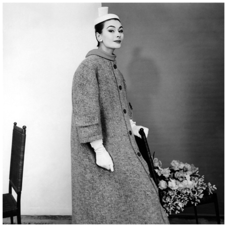 Model wearing a tweed coat with pockets on the sleeves by Balenciaga, with a hat and gloves 1954 Photo Henry Clarke