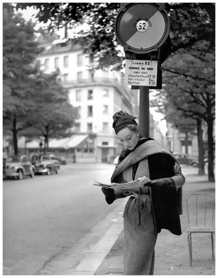 Sophie Litvak in tweed dress with reversible tweed stole lined in otter by Lanvin-Castillo, photo by Georges Dambier, ELLE, September 8, 1952