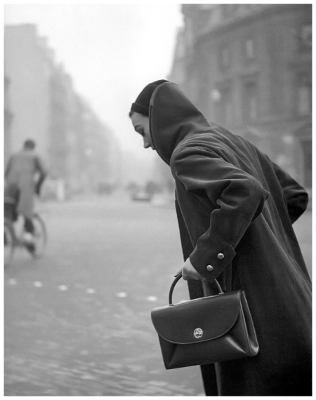 Sophie Litvak wearing coat and handbag by Jacques Fath, photo by Georges Dambier, ELLE, January 12, 1953