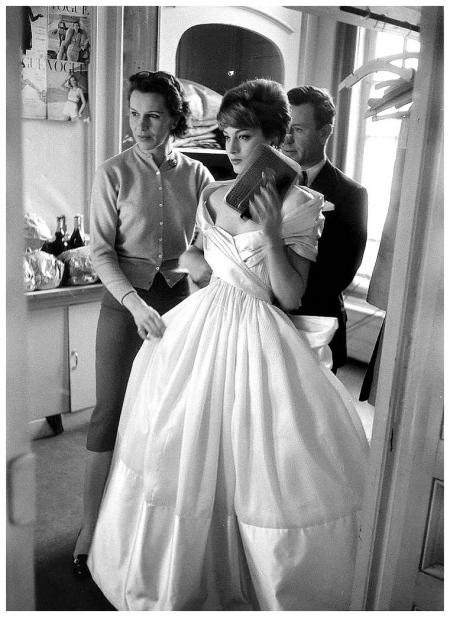 Susan Train fashion editor for Vogue France, model Marie-Hélène Arnaud and photographer Henry Clarke prepare for photo shoot, photo by Loomis Dean for LIFE, 1957