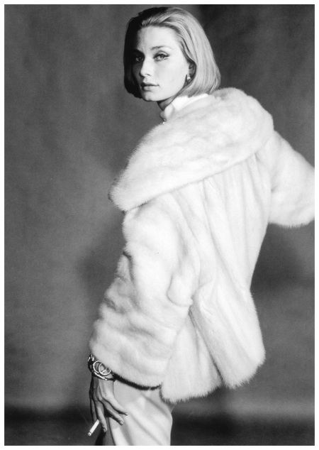 Tania Mallet in a Canadian Pearl Mutation mink with wide set-in sleeves and huge square collar from the National Fur Co., photo by Vernier, Vogue UK, August 1961