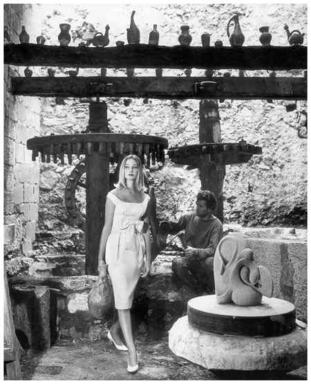Tania Mallet in scoopnecked cocktail dress in Italian strawcloth by Monbijou, photo by Vernier in Tourettes-sur-Loup, south of France, Vogue, July 1960