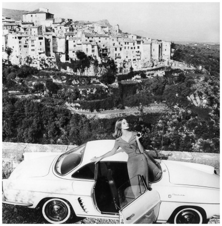 Tania Mallet in wide-collared coral shantung sheath by Matita, photo by Vernier at Tourettes-sur-Loup in the south of France, Vogue, July 1960