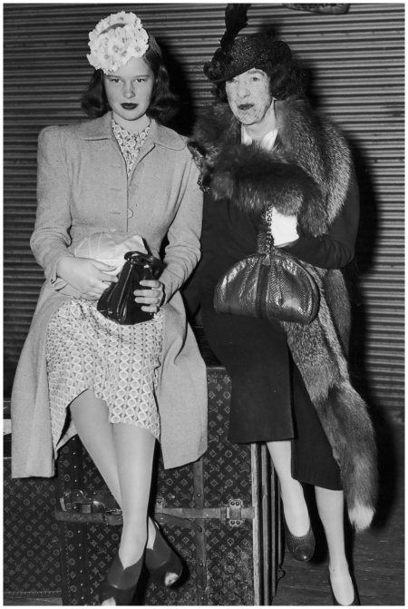 1945 - Gloria Vanderbilt and her aunt, Gertrude Vanderbilt Whitney - fondly known in New York society as Glo and Gert - sitting on top of a Louis Vuitton trunk after returning from a cruise Photo By Getty Images