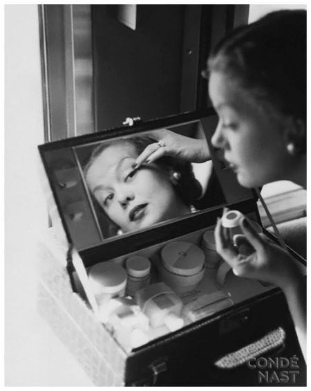 Constantin Joffé captured Mrs.Thomas Phipps applying makeup 1951 Vogue