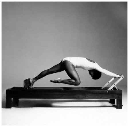 Dancer Paula Kelly exercising on the %22Reformer%22 machine, designed by fitness instructor Ron Fletcher 1975 Francesco Scavullo