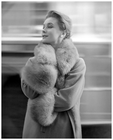 Gigi is wearing a coat with collar,cuffs and lining of guanaco by Chanel, photo by Georges Dambier, ELLE, September 2, 1957