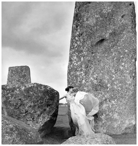 Model Cherry Litvinoff in evening dress by Matilda Etches, photo by Clifford Coffin, Stonehenge, Wiltshire, England - April 1948