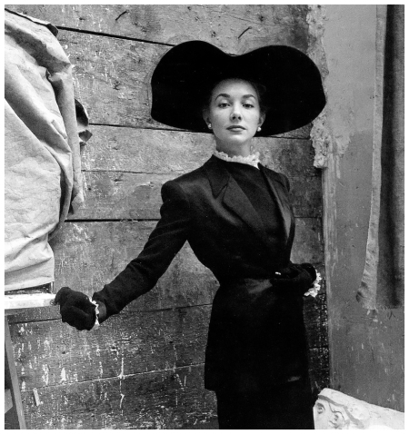 Model in suit by Balmain and hat by Legroux, photo by Clifford Coffin at the studio of Louis Leygue, Paris, British Vogue, April 1947
