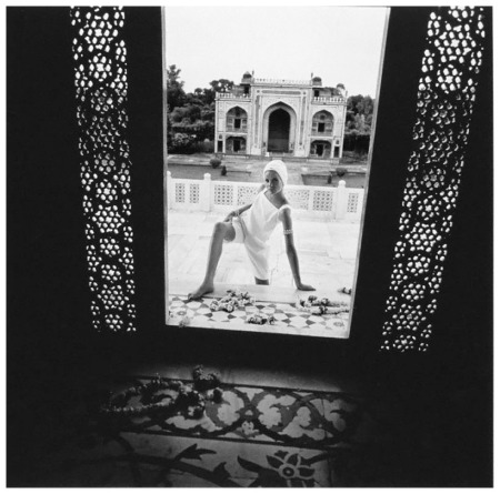Model wearing white culotte dress by Lanz and turban by Jean Barthet for Gres, at the monument for Itimad ud-Daula, in Agra, India Photo Henry Clarke 1964