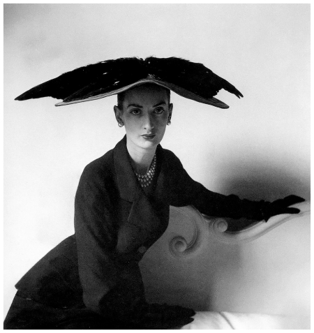 Unknown model is wearing hat and suit by Balenciaga, photo by Clifford Coffin, Paris, February 1948