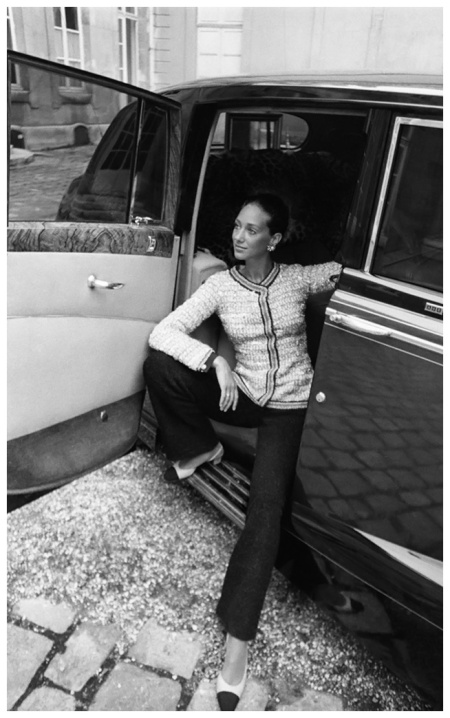 Marisa Berenson, seated in the back seat of a Rolls Royce, wearing a Chanel pant suit 1969 Photo Arnaud de Rosnay