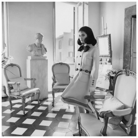 Model stands in the Roman apartment of Cy Twombly among a bold black and white tiled floor, wearing a wool Valentino coat with a wooden belt. Circa March 1968 Benedetta Barzini Photo Henry Clarke