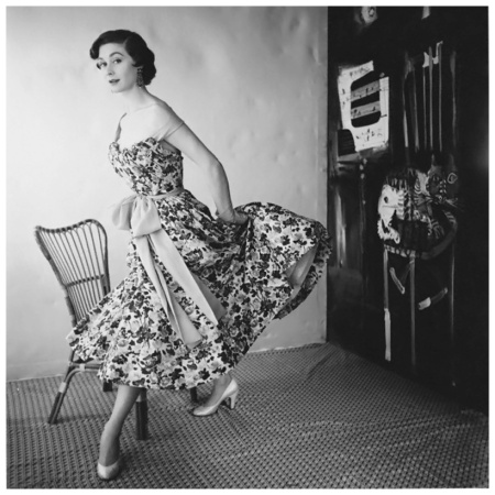 Model wearing floral dress with sash by Schiaparelli 1954 Photo Henry Clarke