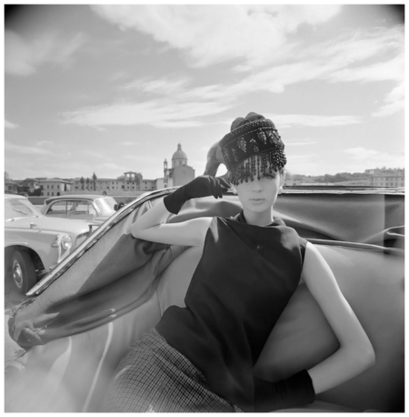 1964 Vogue fashion shoot, a model poses in an open-topped carriage in Florence