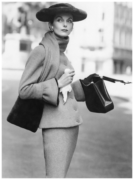 Anne St. Marie in Fath's wool suit with collar-scarf and cuffs trimmed in beaver, wide brimmed hat also beaver, photo by Henry Clarke, Vogue, September 1955