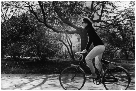 Jacqueline Kennedy Onassis (1929 - 1994), former US first lady and the wife of Greek shipping magnate Aristotle Onassis, rides a bicycle through Central Park Photo by Larry Zumwalt NYC 1970 Getty Image