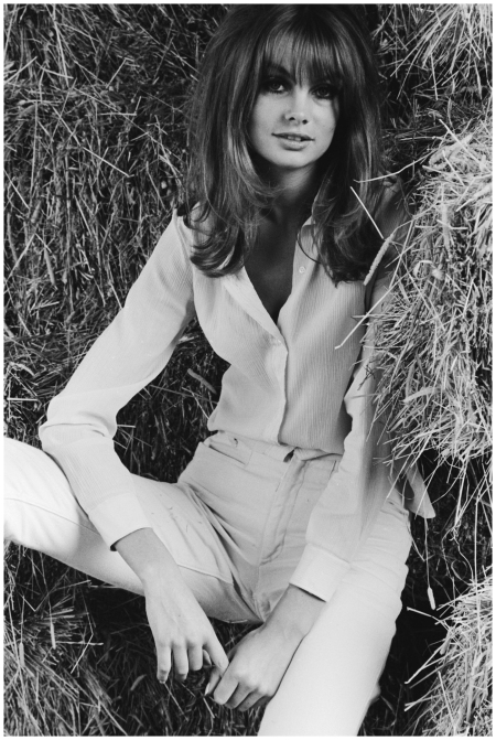 JANUARY 1970 - Photographed by Terry O'Neill in high-waisted trousers and an unbuttoned blouse