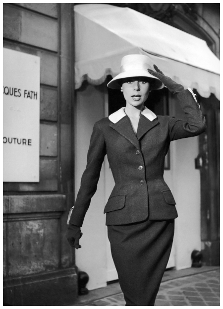 Stella is wearing an afternoon suit by Jacques Fath, photo by Walde Huth, 1955