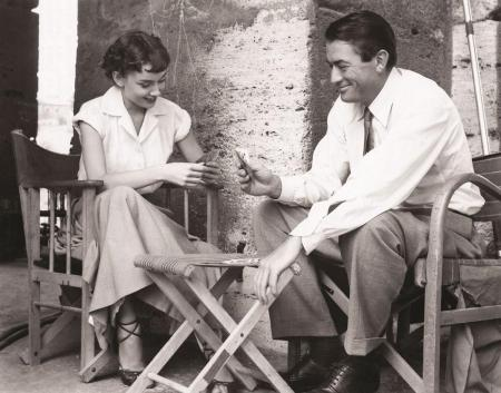 Audrey Hepburn and Gregory Peck on a break between takes while filming Roman Holiday.