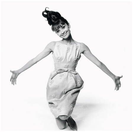 Givenchy Photo Bert Stern - Vogue  Conde Nast Inc 1963 Actress Audrey Hepburn kneels with her arms oustreached in an embroidered dress by Givenchy
