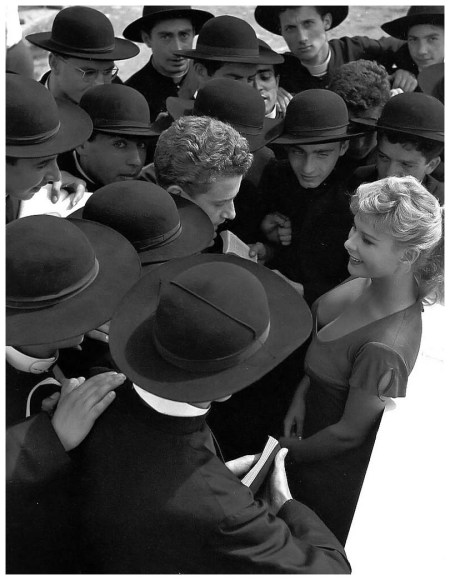 Italian actress Marisa Allasio is surrounded by admirers, photo by Pierluigi Praturlon Rome, 1955
