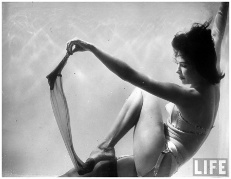 Stripper Divena performing her act inside a plexiglas tank filled with water at Casino Royale Club 1949 Loomis Dean