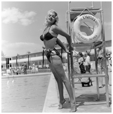 American film actor and sex symbol Jayne Mansfield (1933 - 1967) poses in a bikini by a lifeguard chair at the Dunes Hotel, Las Vegas, Nevada, mid 1950's. (Photo by Hulton Archive:Getty Images)